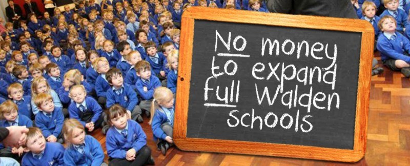 Banner: Schools full and no money